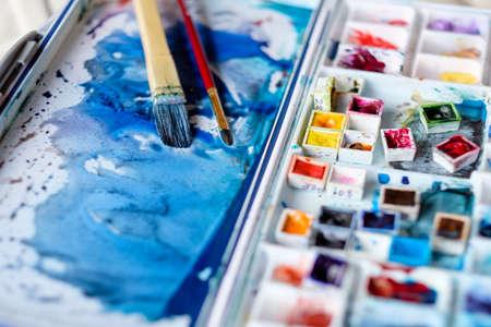 Foto de art painting inspiration creativity concept. mixed ink colors. watercolor palette and brushes. artist instruments. - Imagen libre de derechos