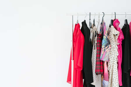 Photo for fashion and clothing. personal style and popular trends. self expression and creativity. selection of bright clothes hanging on the rack. white background with free space. - Royalty Free Image