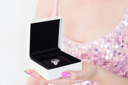 Photo pour symbol of love and commitment. woman holding diamond engagement ring in a gift box. marriage and strong relationship concept. - image libre de droit