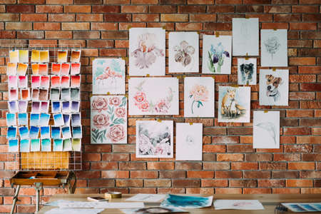 Photo pour art painting skills. beautiful watercolor drawings collection and color swatch palette on the brick wall. works of a gifted painter. - image libre de droit