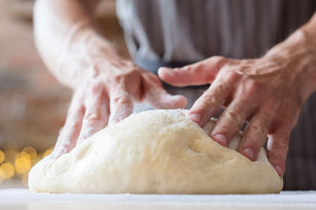 Photo pour baker courses. food preparing and culinary training class concept. man hands ready to knead dough. - image libre de droit