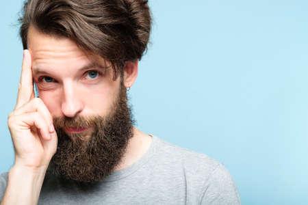Foto de intelligence and smart ideas concept. mind games and brain power. smug confident bearded man portrait on blue background. - Imagen libre de derechos