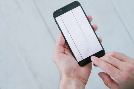 Photo pour blogger taking photos of white wooden background. social media influencer creating content for channel. hands holding smartphone. mobile photography concept - image libre de droit