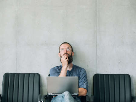 Foto de pensive thoughtful man looking up. job candidate and business recruitment concept. empty space for text. - Imagen libre de derechos