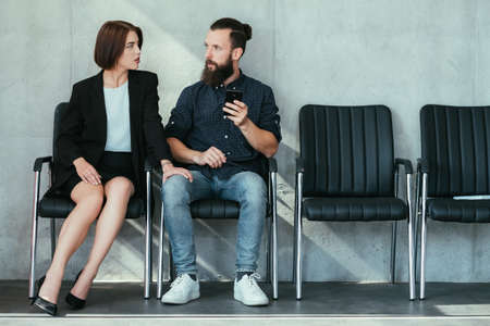 Photo for woman touching mans knee. work harassment flirt and seduction. - Royalty Free Image