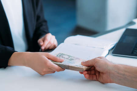 Photo for woman receiving money in office. business bribery and illegal payments - Royalty Free Image