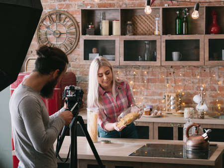 Photo for Cooking blog. Business and lifestyle. Couple shooting tutorial Pasta review. Backstage photography. - Royalty Free Image