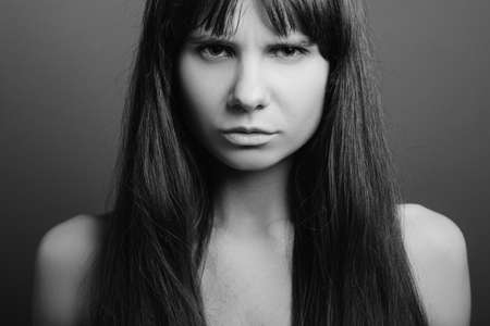 Foto de Distrustful looking beautiful girl. Insecure facial expression. Black and white closeup portrait of emotional lady. - Imagen libre de derechos