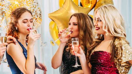 Foto de Hen party. Female friendship. Girls looking jealous of their bestie. Fake happiness for lucky woman. - Imagen libre de derechos