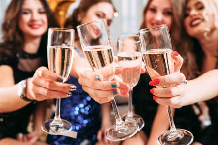 Photo for Girls party. Closeup of glasses with champagne. Young ladies celebrating special occasion, having fun together. - Royalty Free Image
