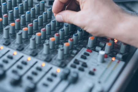Photo for Sound recording and audio production studio. Closeup of man hand mixing tracks, adjusting tune effects. - Royalty Free Image