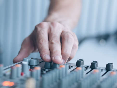 Photo for Music producer professional career. Closeup of man hand adjusting sound effects. Copy space. - Royalty Free Image