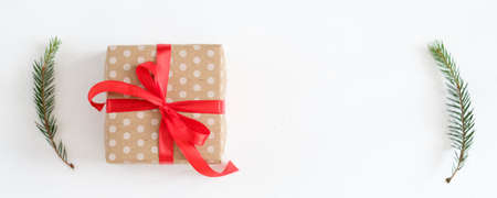 Foto de Christmas surprise. Congratulation greeting present. Gift box. Fir tree sprigs decor. - Imagen libre de derechos