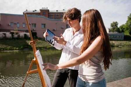 Photo pour Prototype artist gadget outdoor concept. Net search for the inspiration. Professional discussion. Working process. - image libre de droit