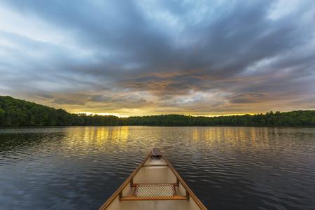 Foto de Canoe bow on an Ontario lake at sunset - Canada - Imagen libre de derechos