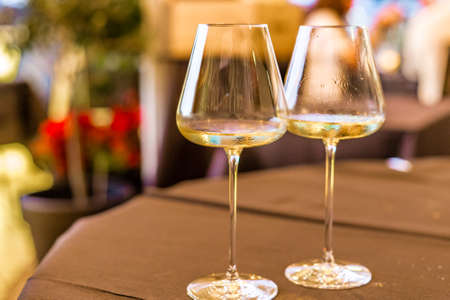 Photo for humid white wine goblets on restaurant table - Royalty Free Image