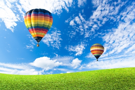 Photo for Colorful hot air balloon over green fields - Royalty Free Image