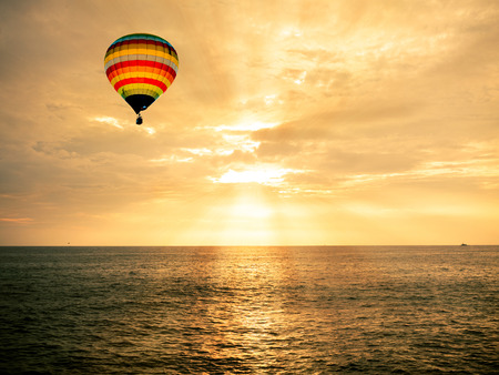 Photo for Hot air balloon over the sea at sunset - Royalty Free Image