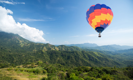Photo for Hot air balloon over mountain and blue sky background - Royalty Free Image