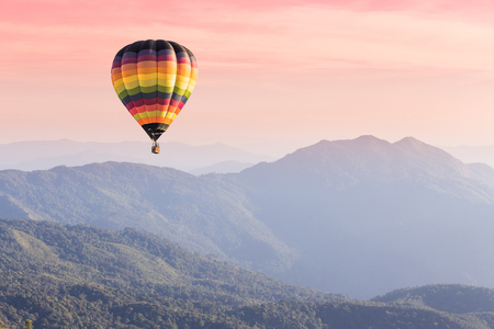 Photo for Hot air balloon above high mountain at sunset - Royalty Free Image