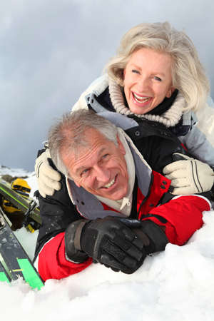 Senior couple having fun at ski resort