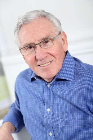 Portrait of elderly man with eyeglasses