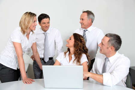 Group of office workers in front of laptop computer