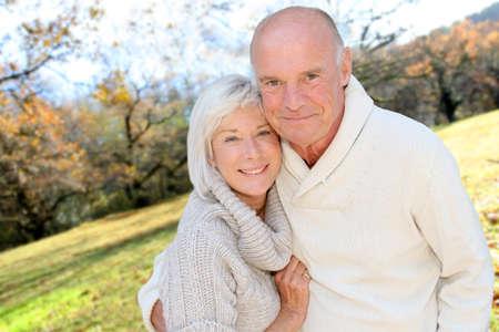 Closeup of senior couple in countryside