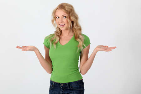 Beautiful woman wearing green shirt with surprised look