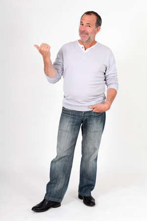 Photo for Senior man standing on white background and pointing at message - Royalty Free Image