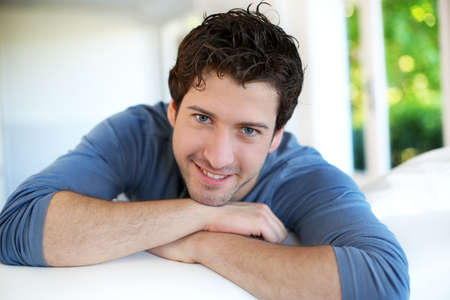 Photo for Closeup of attractive young man relaxing at home - Royalty Free Image