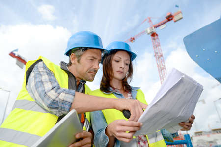 Foto per Construction manager and engineer working on building site - Immagine Royalty Free