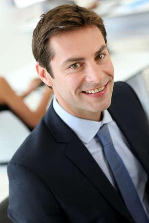 Portrait of businessman wearing dark suit