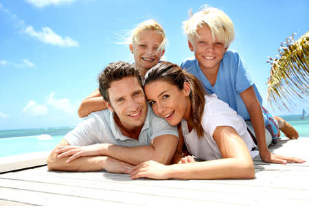 Portrait of cheerful family on vacation in Caribe