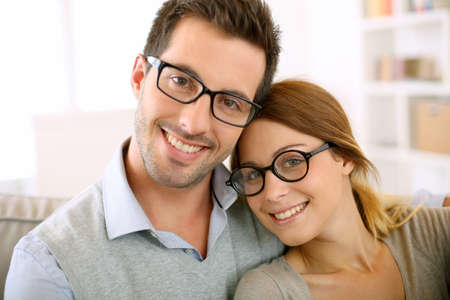 Foto de Cute young couple with eyeglasses on - Imagen libre de derechos