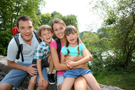 Photo pour Happy family relaxing on a bridge  - image libre de droit