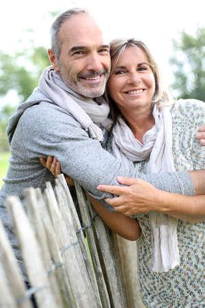 Foto de Cheerful senior couple enjoying peaceful nature - Imagen libre de derechos