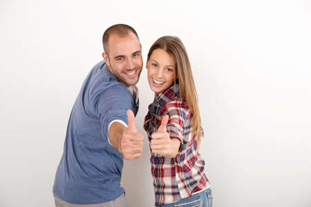 Photo pour Cheerful couple showing thumbs up - image libre de droit