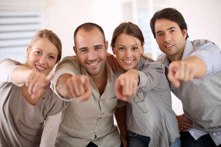 Photo pour Business people pointing at camera - image libre de droit