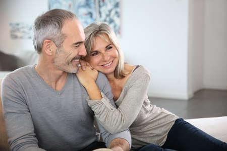 Photo pour Romantic senior couple relaxing in couch  - image libre de droit