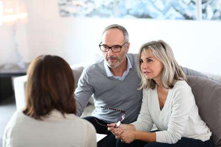 Foto de Senior couple meeting financial adviser for investment - Imagen libre de derechos