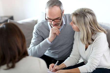 Photo pour Senior couple meeting financial adviser for investment - image libre de droit