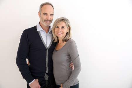 Photo pour Cheerful senior couple standing on white background - image libre de droit