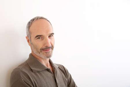 Photo pour Portrait of 50-year-old man standing on white background - image libre de droit
