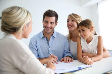 Photo pour Family meeting real-estate agent for house investment - image libre de droit