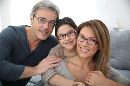 Photo pour Portrait of family of 3 people wearing eyeglasses - image libre de droit