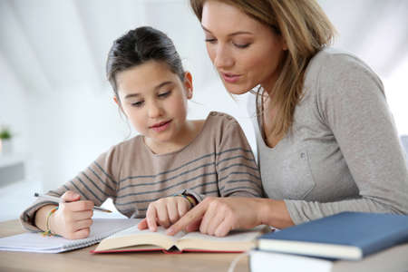 Photo for Mom helping kid with homework - Royalty Free Image