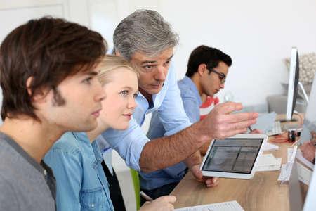 Foto de Teacher using digital tablet in school class - Imagen libre de derechos