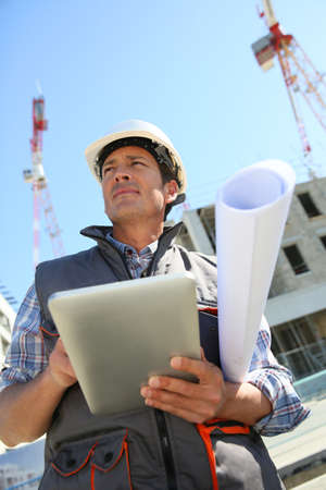 Photo for Entrepreneur on building site using tablet - Royalty Free Image