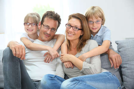 Photo pour Portrait of happy family of four wearing eyeglasses - image libre de droit